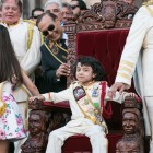 El 69th Rey Feo Fred Reyes's son Preston, 6, sits on the throne after his father is crowned.