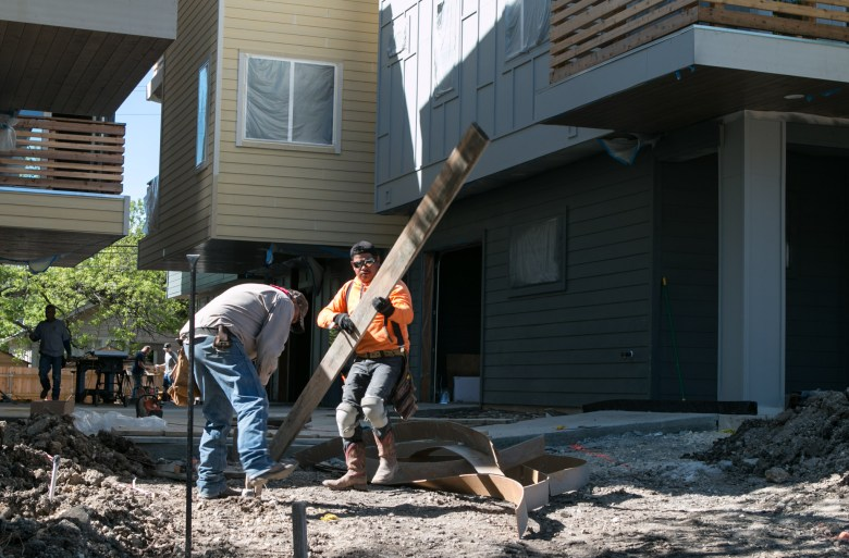 Construction workers build a new apartment complex for urban living in Beacon Hill at 930 W. Craig Pl.