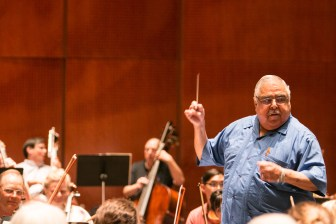 Bexar County Commissioner Precinct 2 Paul Elizondo conducts practice for the Fiesta Pops concert in the Tobin Center for the Performing Arts.