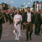 Nora Aceves and Councilman Roberto Treviño (D1) walk as Star Wars characters in the Fiesta Flambeau Parade.