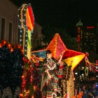 The San Antonio Shoemakers wave to the crowd during the Fiesta Flambeau Parade.