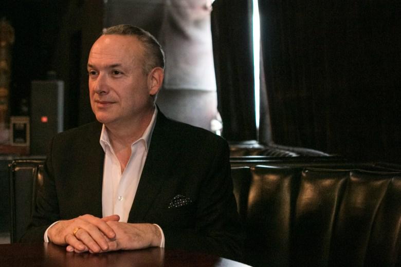 Ken Slavin poses for a portrait inside Sam's Burger Joint.