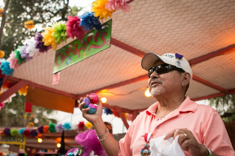 Philip Moreno holds up cascarones for sale at NIOSA.
