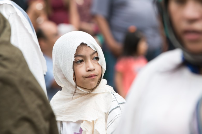 A young child actress participates at the Passion of Christ Re-enactment at San Fernando Cathedral.