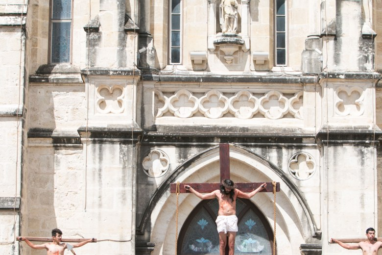 An actor portraying Jesus is hung in the Passion of Christ Re-enactment at San Fernando Cathedral.