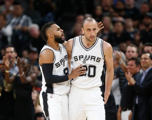 Patty Mills #8 of the San Antonio Spurs congratulates Manu Ginobili #20 of the San Antonio Spurs after a defensive effort against the Memphis Grizzlies in Game Five of the Western Conference Quarterfinals during the 2017 NBA Playoffs at AT&T Center on April 25, 2017 in San Antonio, Texas.