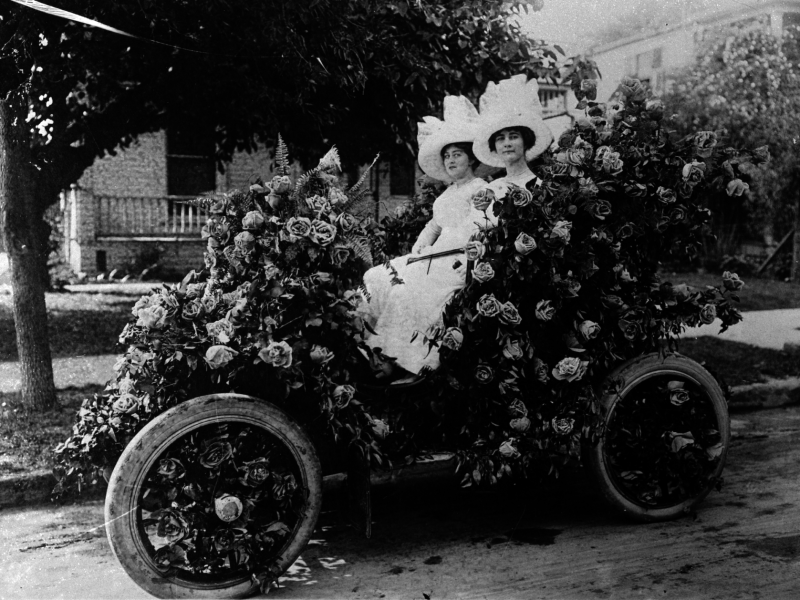 Battle of Flowers Parade, 1914. Henrietta Hummel (left) and Helen Guenther in electric car decorated with American Beauty roses.