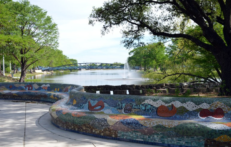 Colorful mosaic tile benches are found at the entrance to the park.