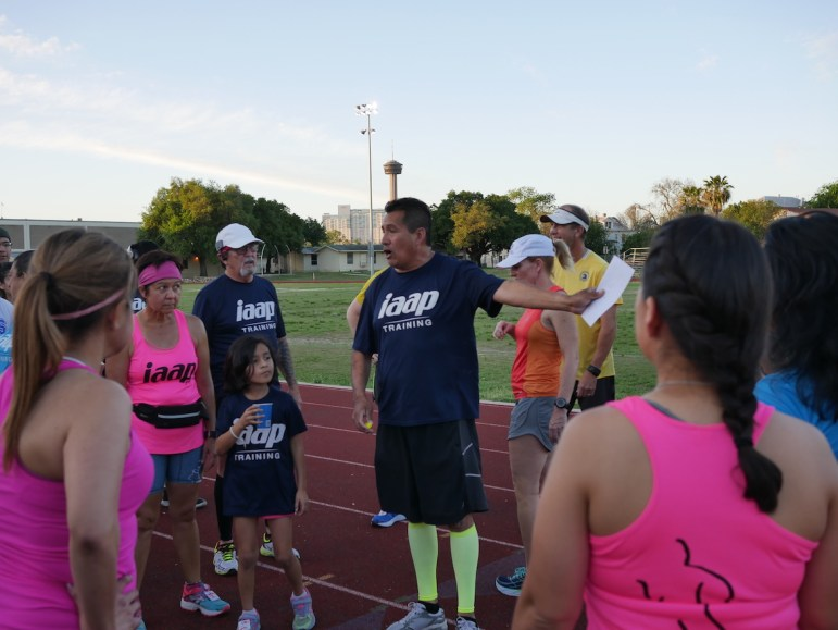 José Iñiguez, founder of the IAAP Training group, leads a workout at Brackenridge High School. Photo by Noi Mahoney