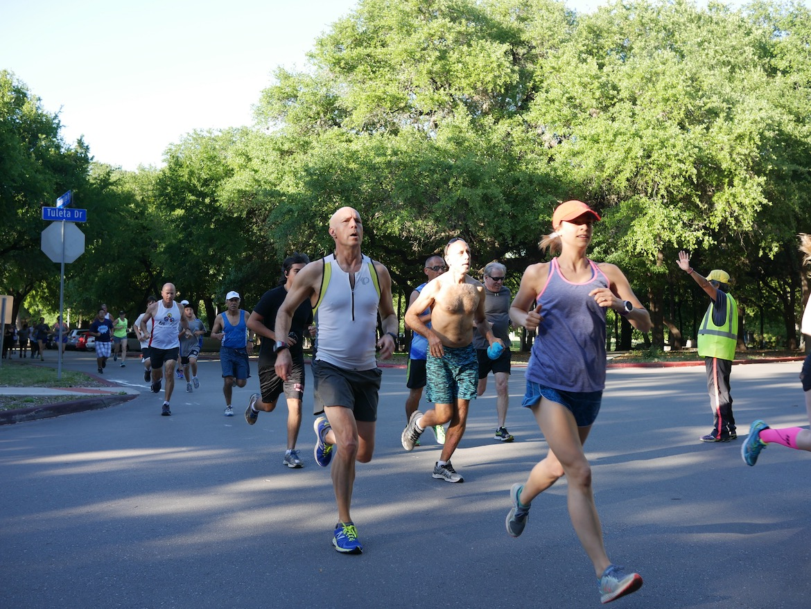 Runners participate in the Wednesday Night Zoo Run on April 5. The event is a free 2-mile race/fun run held every week at Brackenridge Park, from April through October. Photo by Noi Mahoney