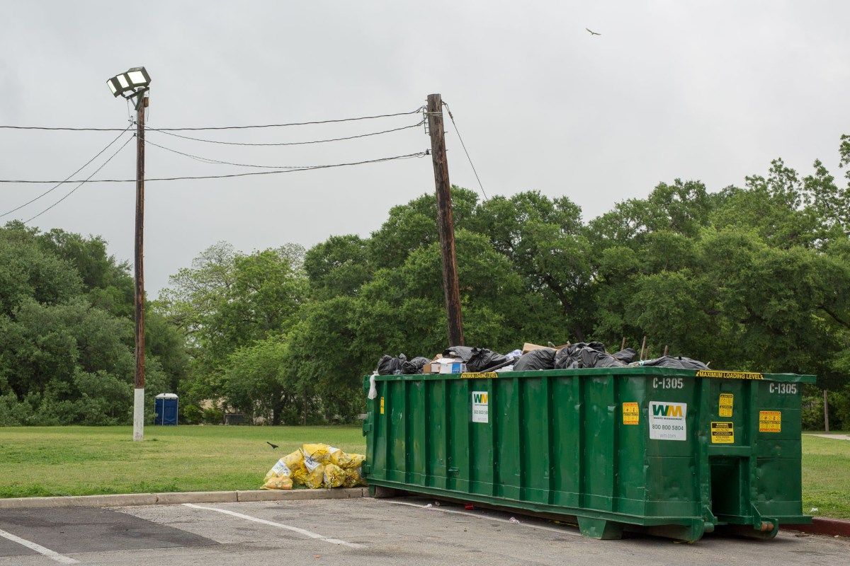 A dumpster full of trash from Easter weekend in Brackenridge Park.