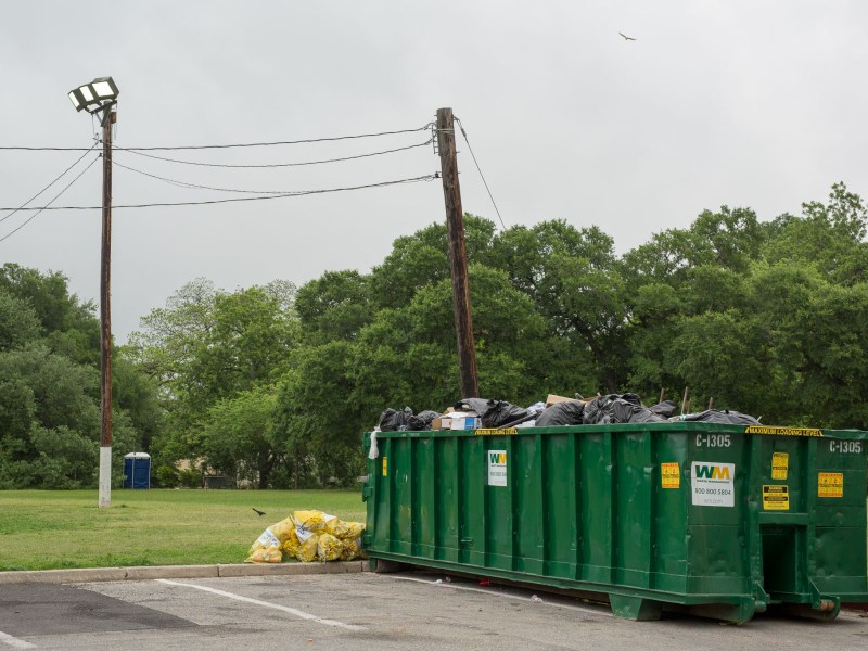 A dumpster full of trash from Easter weekend in Brackenridge Park.