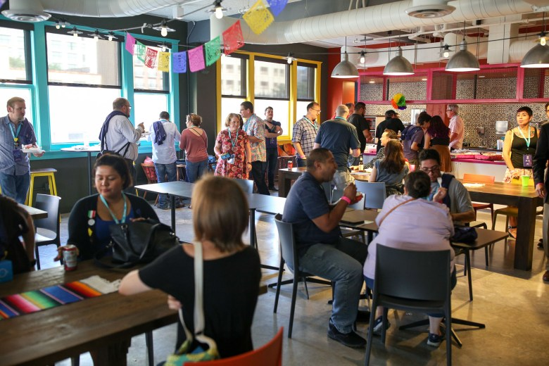 Attendees of the first annual SA Tech Trek help themselves to food at Google Fiber located in the Rand Building.
