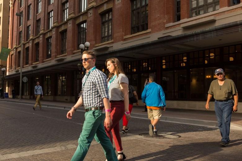 SA Tech Trek attendees walk along East Houston Street near the Vogue Building.