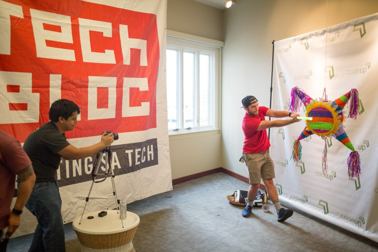 Mathew Espinoza photographs Andrew Haynes as he poses for a photograph in the Tech Bloc space on the 6th floor of the Vogue Building.
