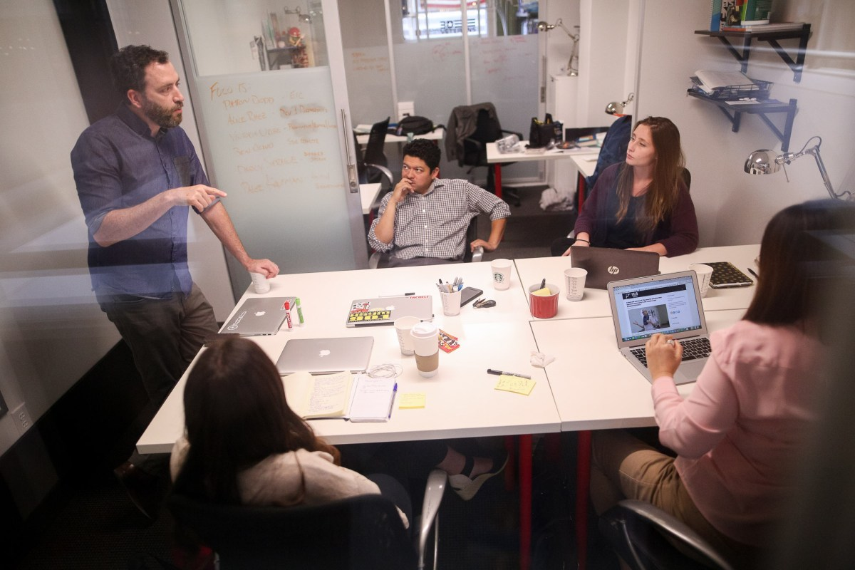 (left) Editor in Chief Patton Dodd leads the weekly Folo Media meeting in their 7th floor office at Geekdom.
