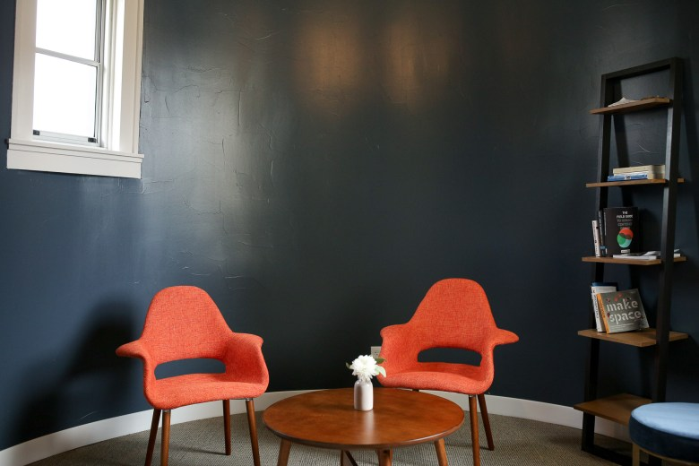 Modern furniture and spaces can be found throughout the co-working space.
