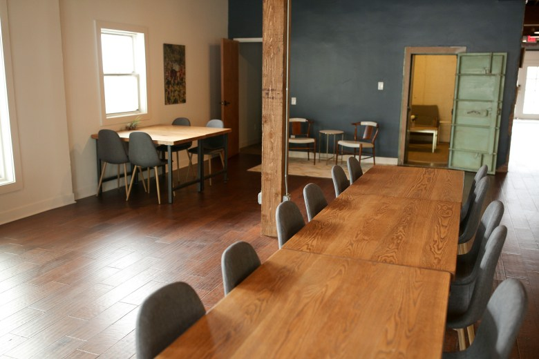Community desks and privates conference rooms including a former bank vault are amenities of the Impact Guild.