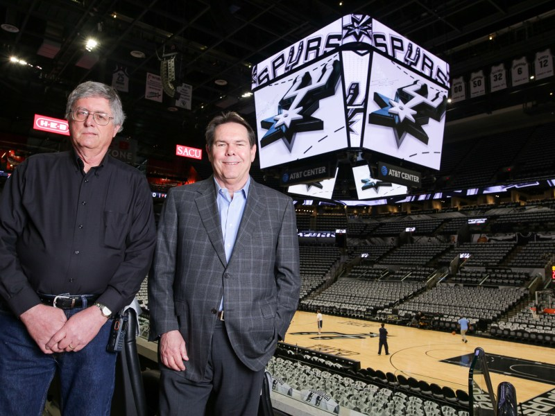 Clinton Rathmell, director of AV Engineering, and Lawrence Payne, executive vice president of Spurs Sports and Entertainment inside the AT&T Center with the JumboTron.