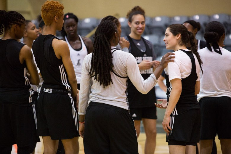 Kelsey Plum interacts with her teammates following a San Antonio Stars practice.