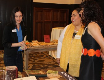 Amy Rushing (left) shows books to Consul General of Mexico in San Antonio, Ambassador Reyna Torres Mendívil