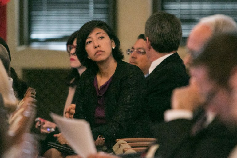 Ana Sandoval looks around the crowd at City Council A Session.