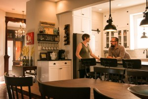 Lauren and Chris Mongeon hang out in the kitchen area of their house on Nolan Street.