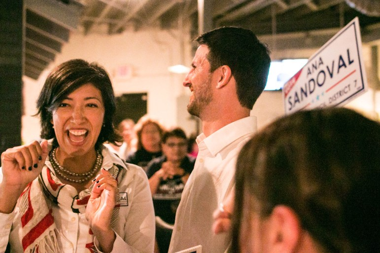 Ana Sandoval cheers when she rises above 50% of the vote at Deco Pizzeria during the election.