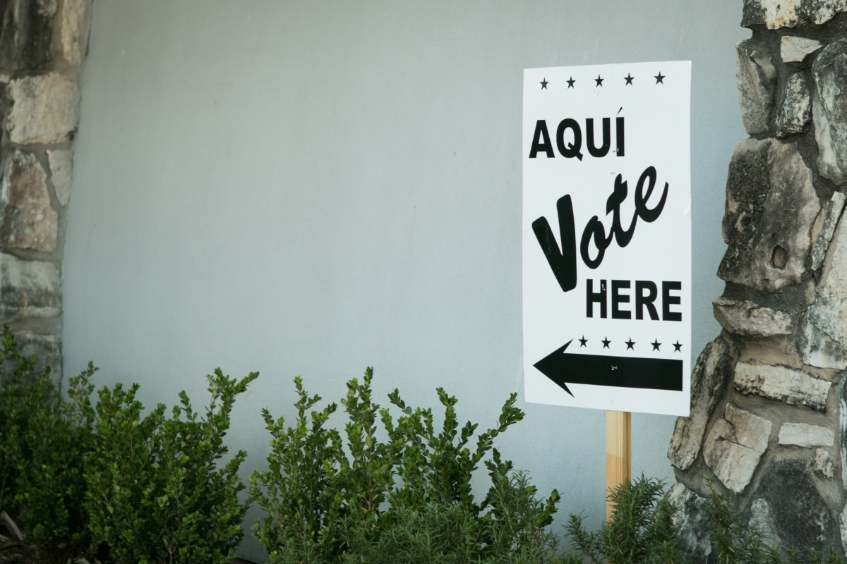 A sign indicates where to vote at the early voting site at Lions Field.
