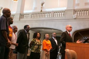 Rev. Paul Wilkinson Sr. of the New Light Baptist Church (right) thanks the City of San Antonio for recognizing the cultural significance of his historic church.