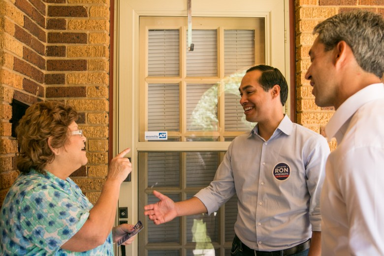 Former Mayor Julián Castro (center) and Councilman Ron Nirenberg (D8) (right) greet citizens in District 7 during their block-walk.