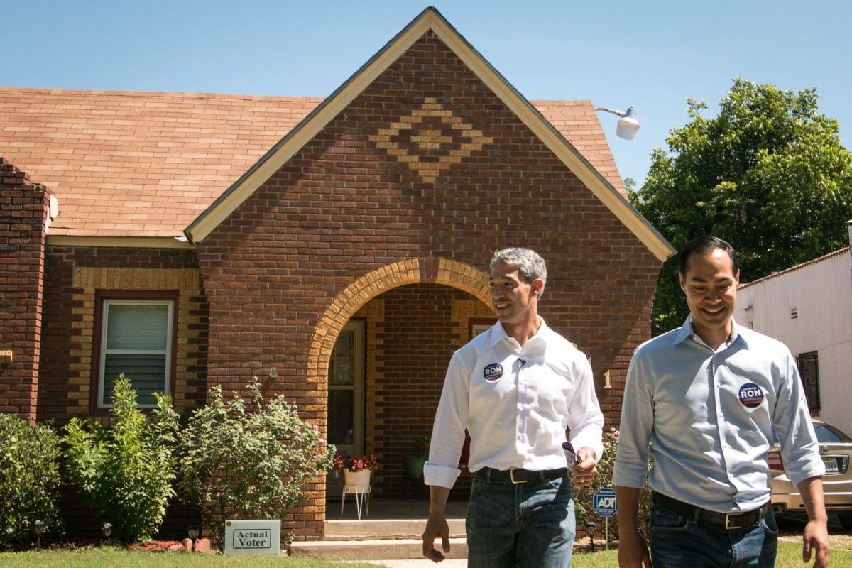 Former Mayor Julián Castro (right) and Councilman Ron Nirenberg (D8) block-walk in District 7 to spread the word for Nirenberg's mayoral campaign.