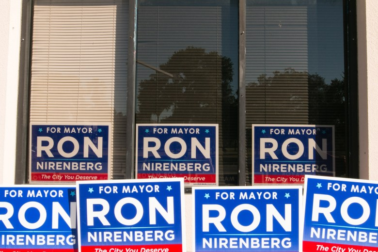 Signs line the outside of Ron Nirenberg's campaign headquarters.