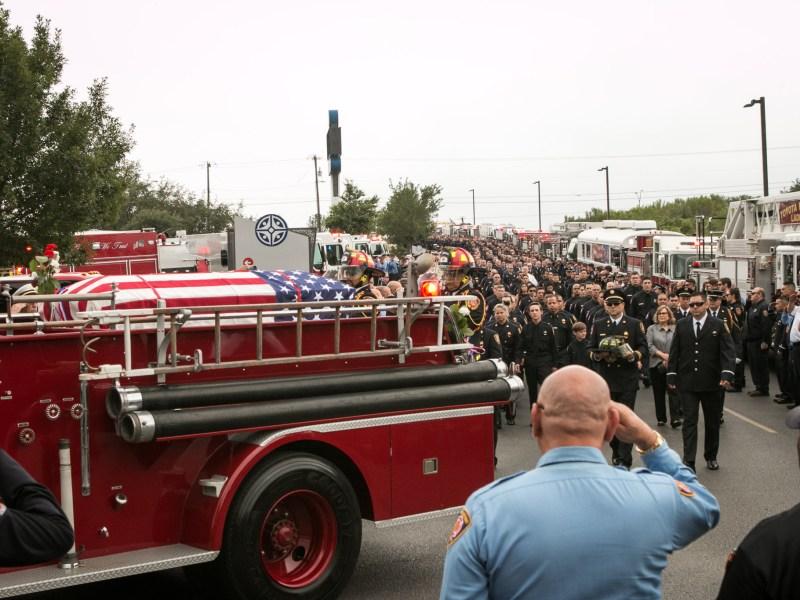 Scott Deem's casket is driven in a procession towards Community Bible Church.