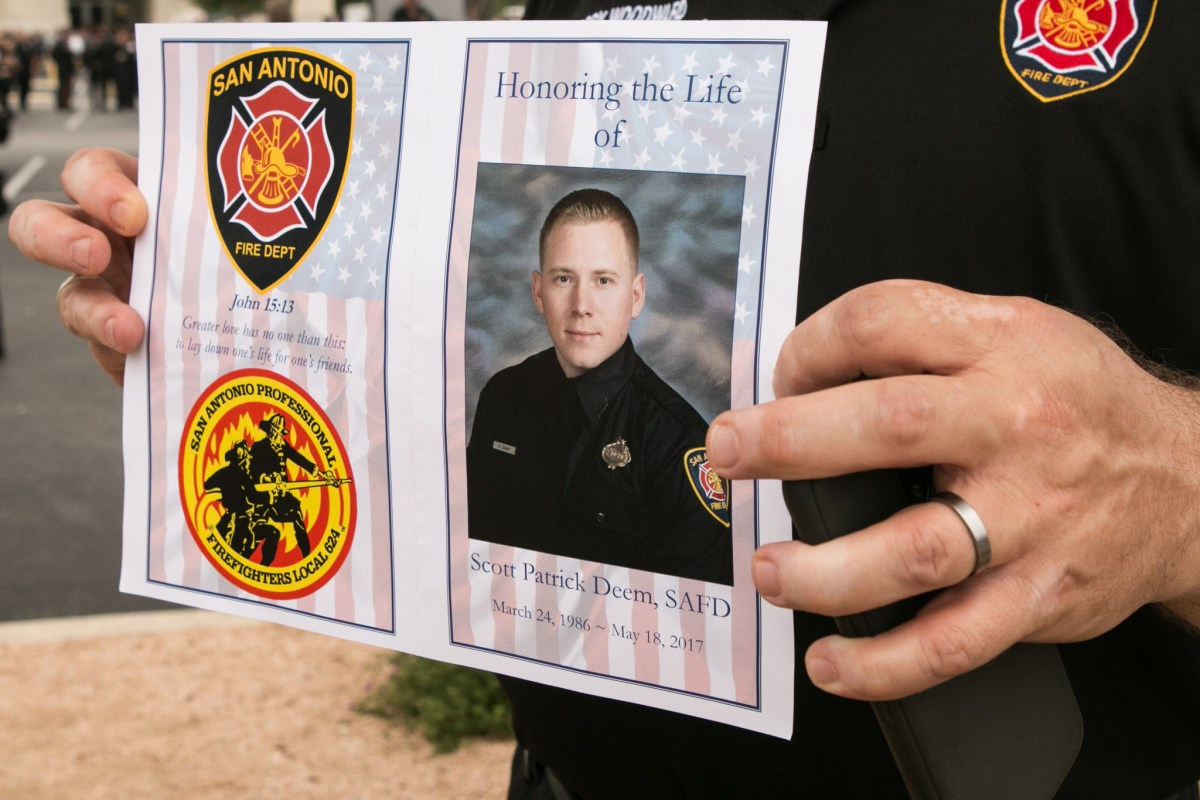 Scott Deem's photograph is featured on the front page of the program honoring his life.
