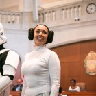 Nora Aceves, along with others dressed in Star Wars costumes, stand in front of City Council.