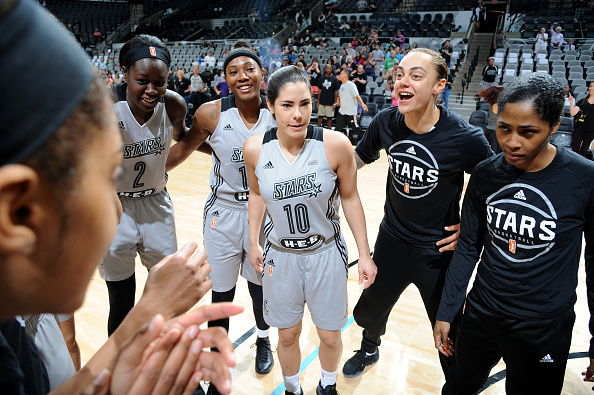 The San Antonio Stars huddle up around Kelsey Plum #10 of the San Antonio Stars before the game against the Dallas Wings during the WNBA Preseason on April 29, 2017 at the AT&T Center in San Antonio, Texas.