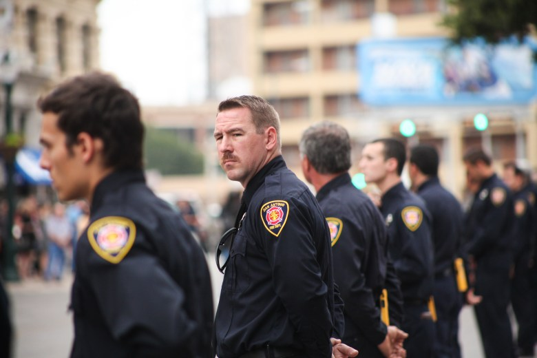 San Antonio firefighters line up along the Alamo Plaza to pay tribute to Scott Deem.