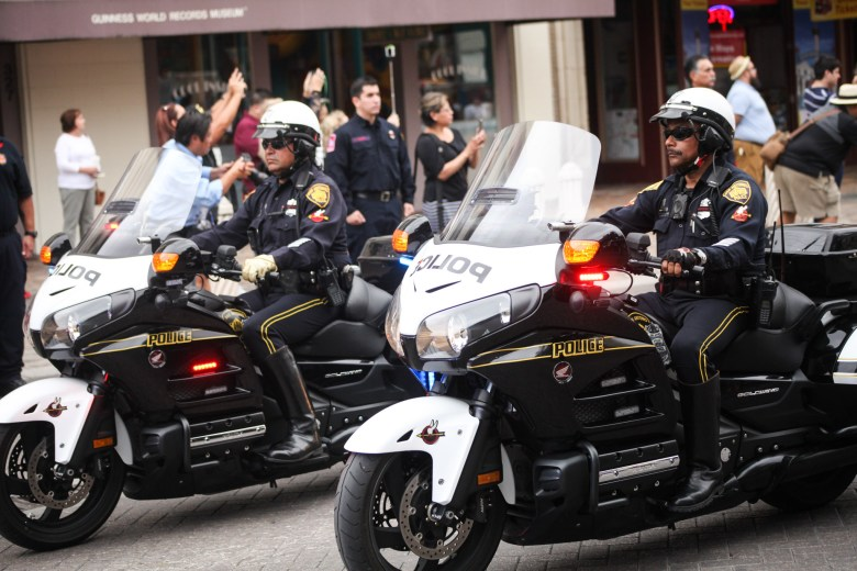San Antonio police officers lead the Scott Deem's family funeral procession at the Alamo Plaza.