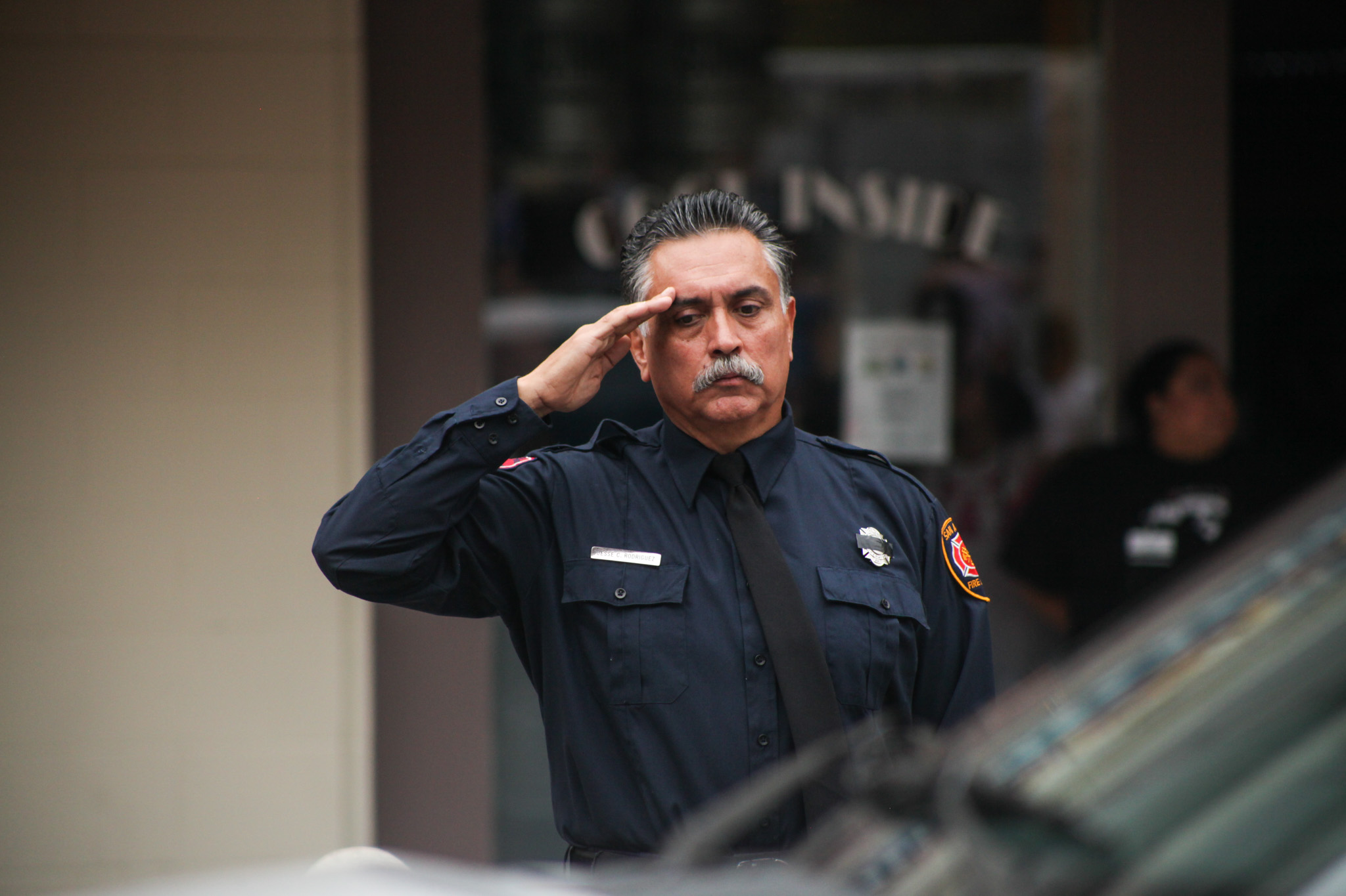 San Antonio firefighter pays tribute to Scott Deem at the family funeral procession.