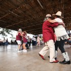 Festival goers make their way around the dance floor at the conjunto festival.
