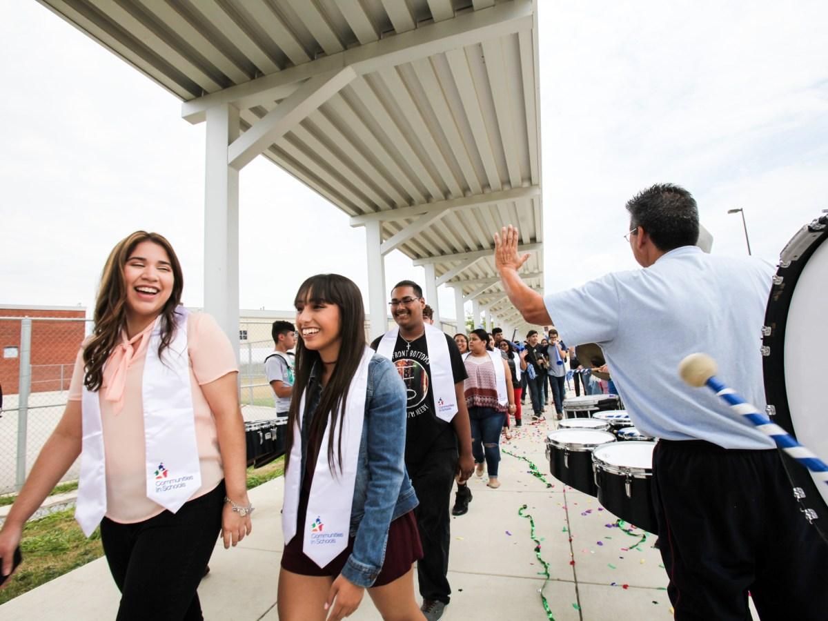 South San Antonio High School seniors, (Left) Audrey Arredondo and Samantha Magna, walk through the drum line at the Surprise Graduation Celebration.