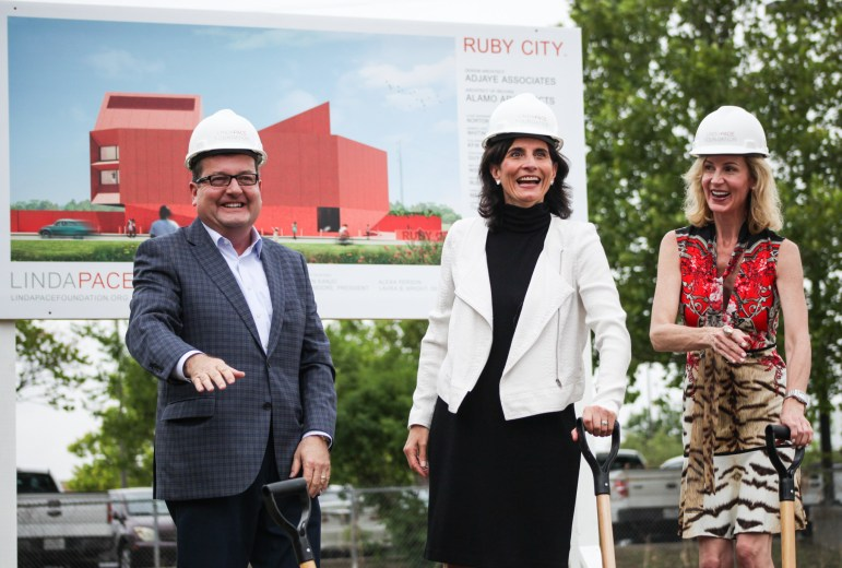 (From left to right) Linda Pace Foundation Trustees Rick R. Moore, Kathryn Kanjo, and Alexa Person laugh after breaking the ground with shovels at the site of Ruby City.