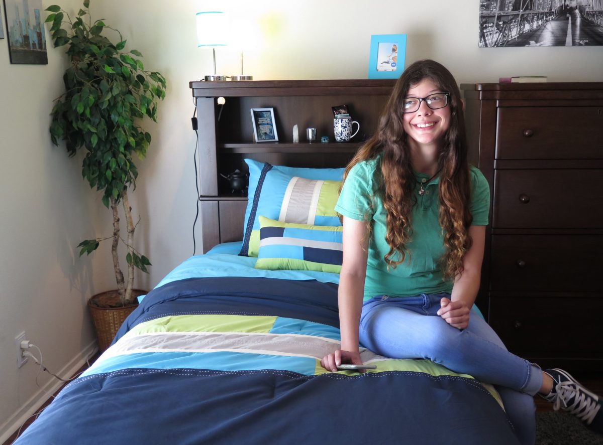 Miranda Vasquez, 19, smiles in her new room at the Roy Maas Youth Alternatives' Koiner House.