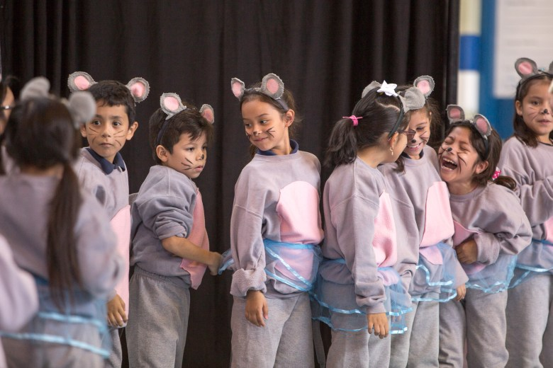 Beacon Hill Elementary School students perform on stage in front of their peers.