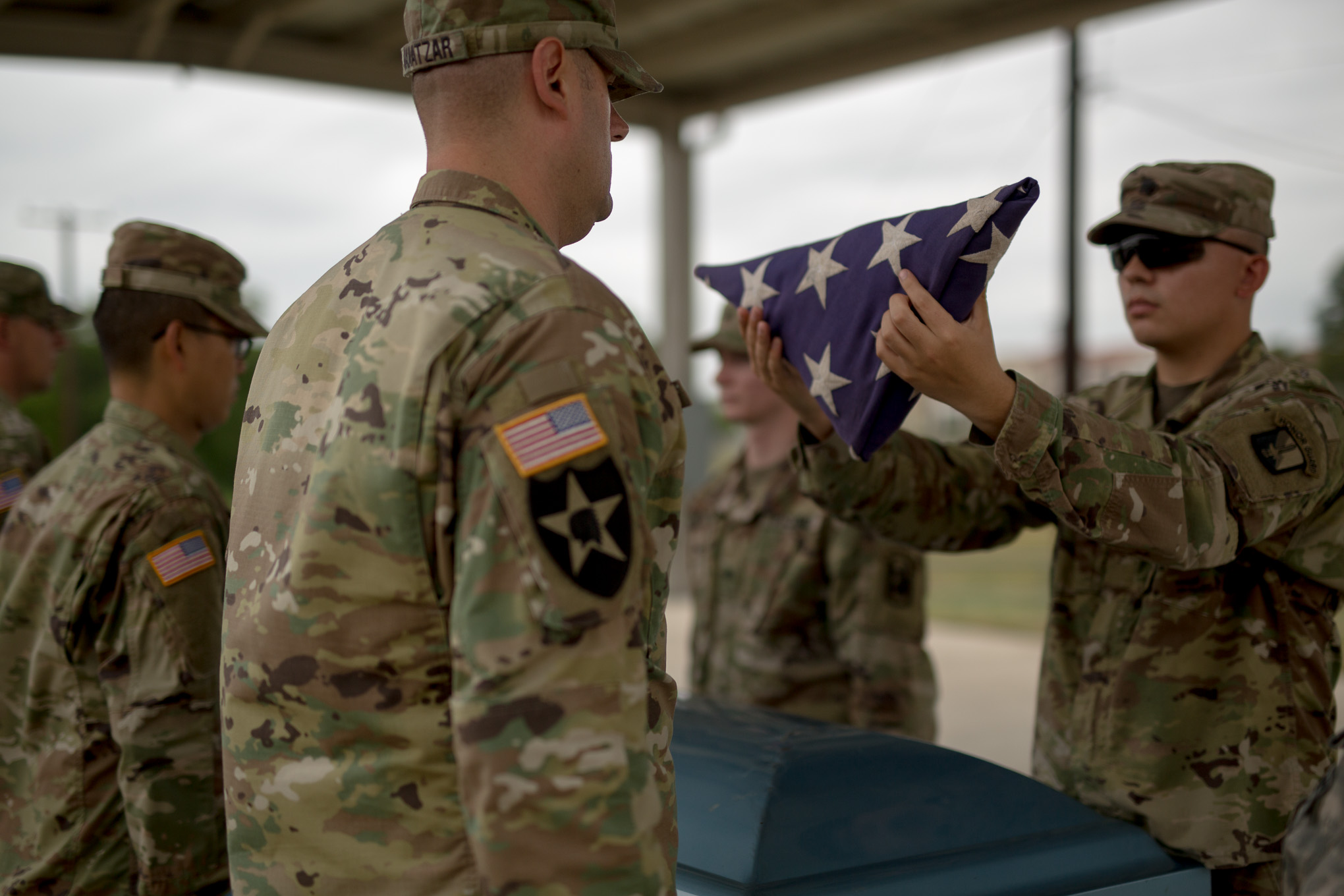 Caisson Unit members present the United States Flag during a practice.