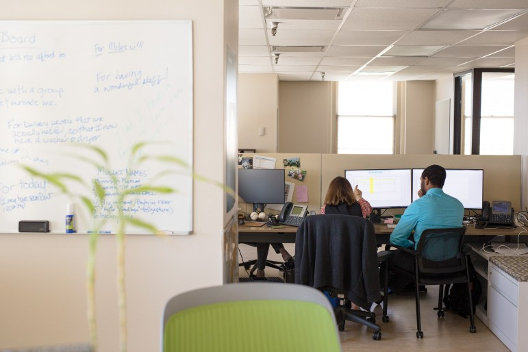Innovation employees work in their open air office space.