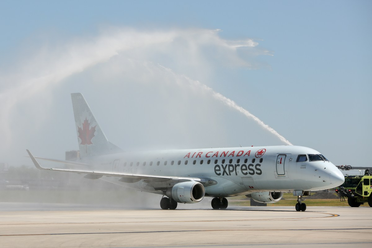 The inaugural direct flight from Toronto to San Antonio is sprayed with water cannons from the San Antonio Aviation Fire Department.