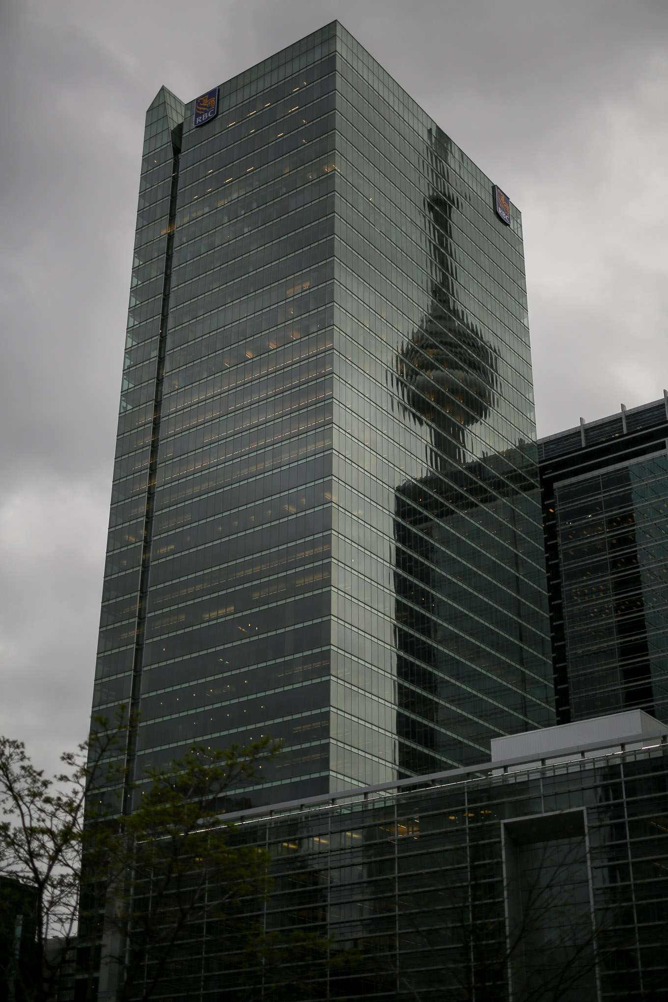 The reflection of CN tower on the Royal Bank of Canada building in Toronto's Financial District.