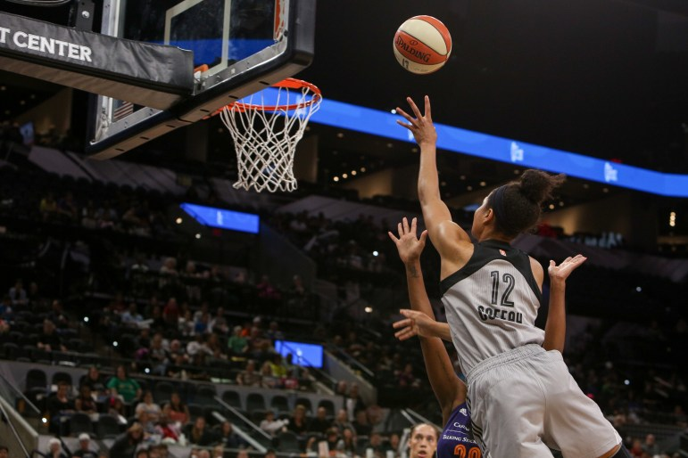Nia Coffey gently releases the ball as she glides towards the basket against the Phoenix Mercury during the season home opener.
